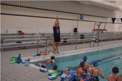 Girls' swim team hires new assistant coach