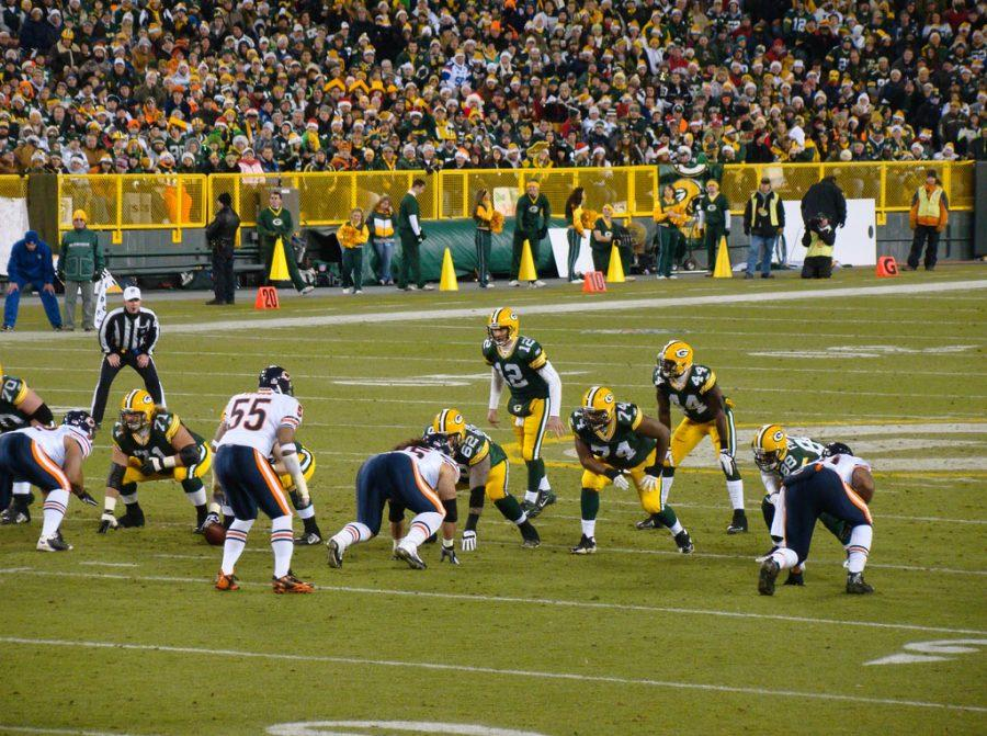 The Green Bay Packers offense, led by Aaron Rodgers (12), lines up against the Chicago Bears defense in their 2011 matchup. The rivalry between these two teams will be renewed Thursday night.