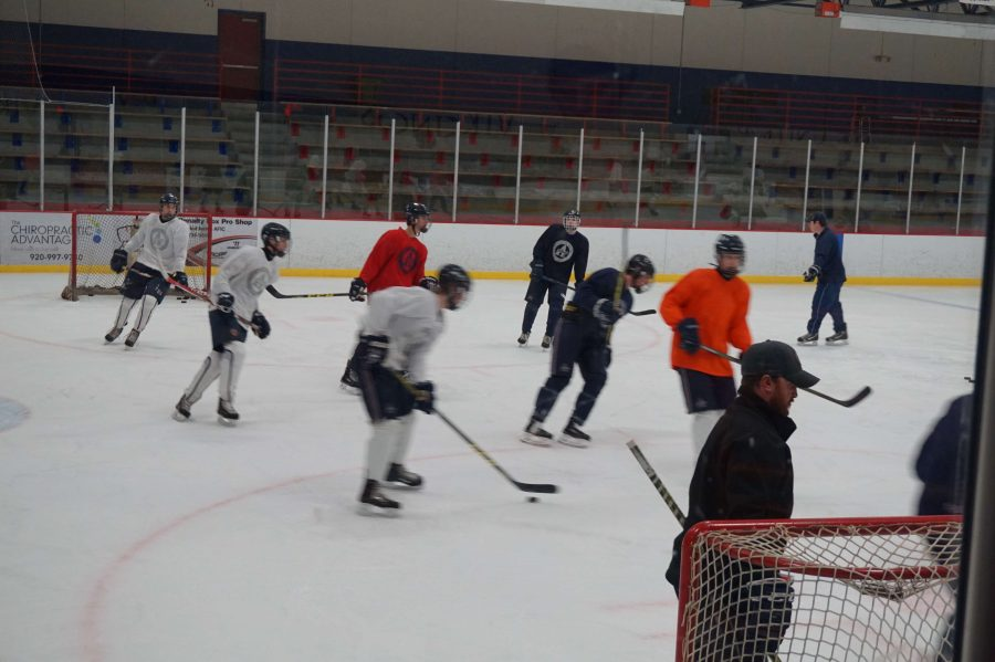 The varsity Boys' Hockey team practices for the upcoming season.