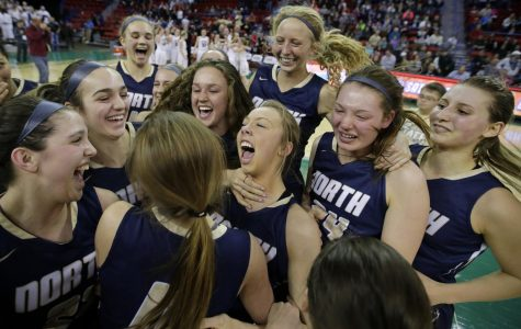 The Lady Lightning celebrating their state championship as the buzzer sounds.