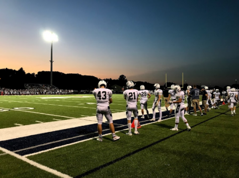 Photo taken by Megan Kitzman. Players standing on the sidelines eager to hit the field.