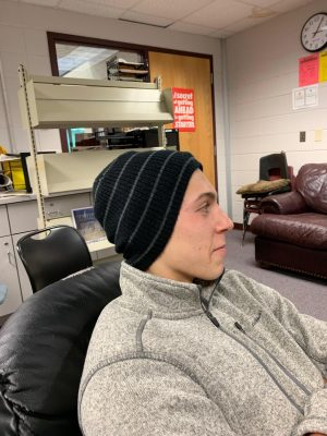 Dominic Gianopoulos, senior at North, wears hat at school.