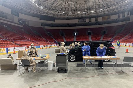 The National Guard helps facilitate Covid-19 testing at the Resch Center, where a large spike in cases has recently been recorded in Green Bay. (Photo credit: Meghan Skrepenski)