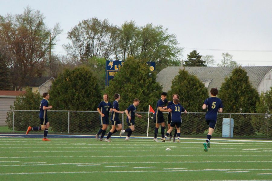 Players celebrate a goal scored in the first minute of the game.